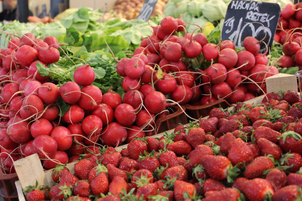 Radish and strawberries at the local farmers market in Budapest