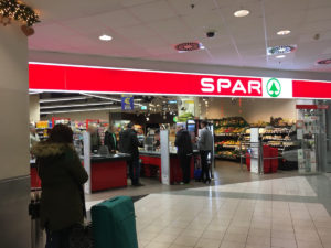There is a Spar at the arrival level where you can buy some snacks for your flight (Budapest Airport)