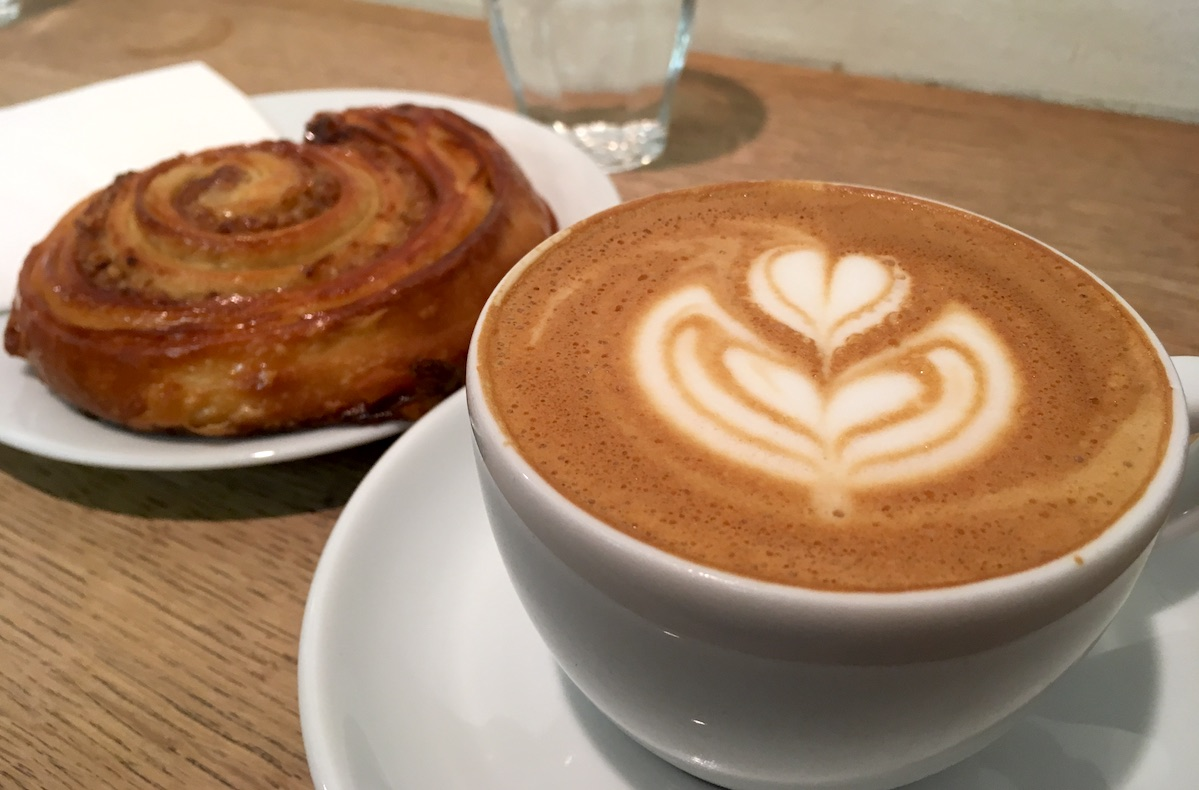 Coffee and pastry by Espresso Embassy