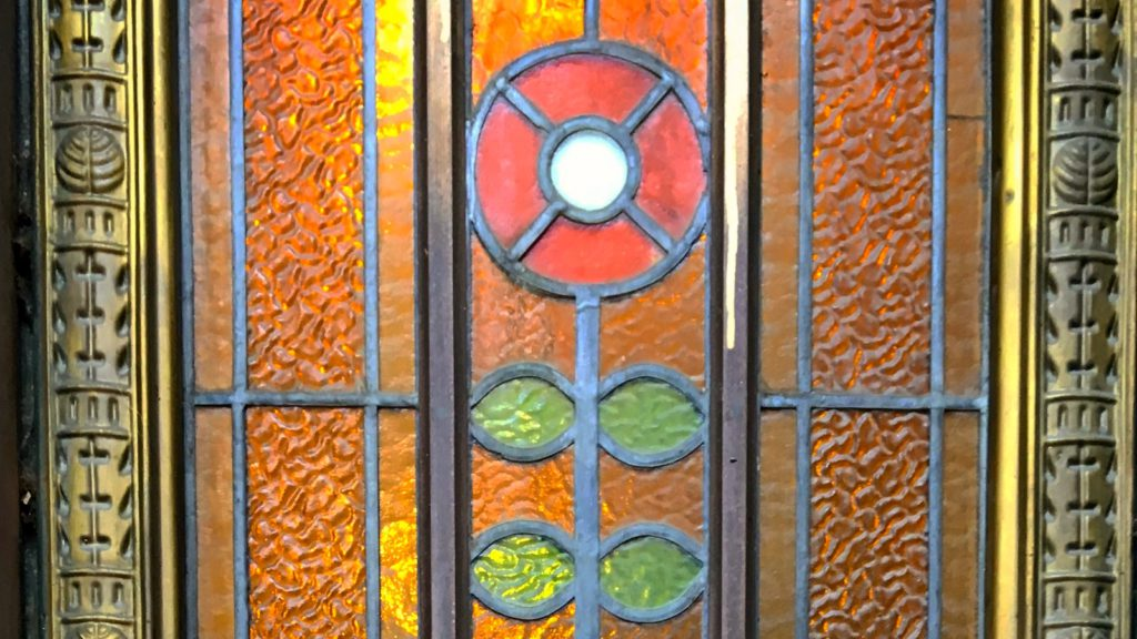 Budapest Art Nouveau Tour - a detail of a stained glass door